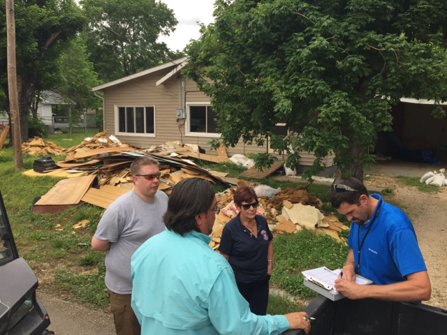 A joint Preliminary Damage Assessment team surveys Missouri flooding damage in Carter County on May 11, 2017.