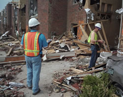 image of SAVE volunteers inspect a building damaged by the EF-5 tornado that struck Joplin on May 22, 2011.